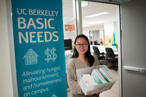Student Jessica Wang of the Coalition for the Institutionalization of Free Menstrual Product  at UC Berkeley poses with a box of menstrual pads