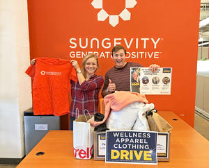 Sungevity employees pose with donated wellness apparel
