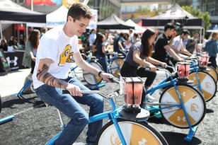 UC Berkeley students pedal their smoothie bikes at the UA-Cal Giveback Challenge event on May 4, 2018