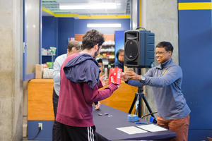 Cori Evans (UHS) hands a participant their Under Armour prize