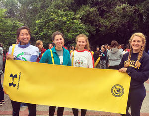 UC Berkeley students holding Under Armour sponsored yoga mat